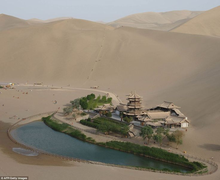 To see a true-blue oasis. | Along the Silk Road, the Yueyaquan Crescent Lake in Dunhuang, Gansu Province, north west China.
