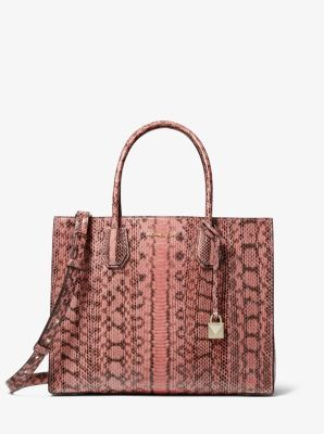 683255e55151 Crafted from genuine snakeskin, this sleek handbag is an ultra-rich take on  our Mercer tote. This streamlined silhouette features structured top  handles and ...