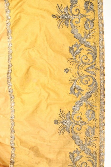 Detail embroidery, petticoat border, c. 1720-1730. Mustard silk worked in silver threads.