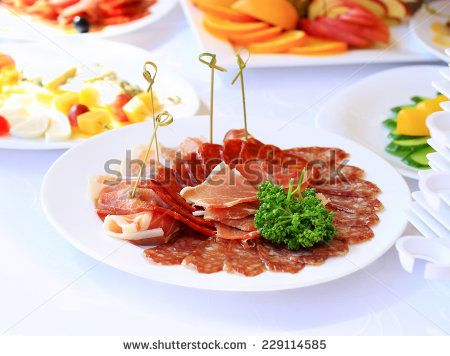 catering table set service with silverware and glass stemware at restaurant before party - stock photo