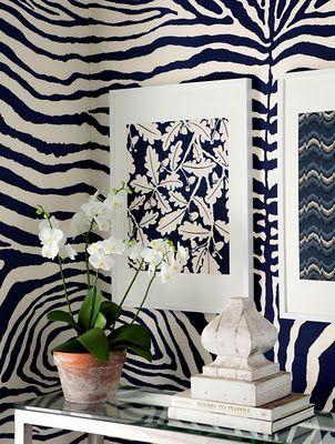 Navy zebra wallpaper and flourishing orchids.... divine. Image via VT Interiors.