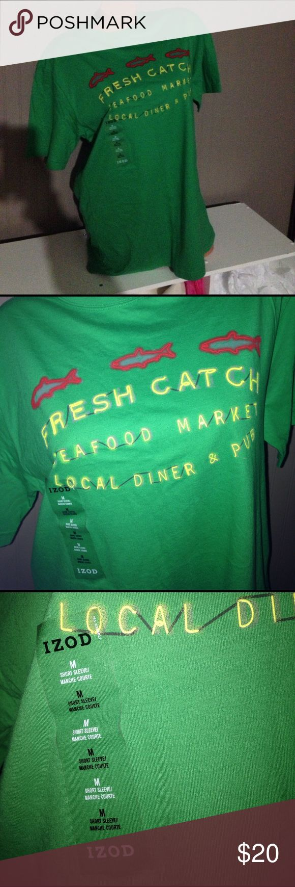 """IZOD men's M green tshirt fresh catch NWT. IZOD. Green w front looks like store sign lights has red fish and yellow letters saying """"Fresh catch seafood market local diner & pub. Short sleeve. Nothing on back. Men. Are you a ladies 'Fresh Catch'? ;) Izod Shirts Tees - Short Sleeve"""