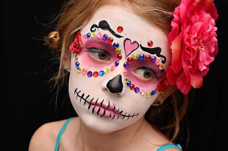 ... a fun dia de los muertos make over/ photo shoot party and the kids had a blast!!! My talented and AMAZING friend Ce Ce did all of the girl's make up!