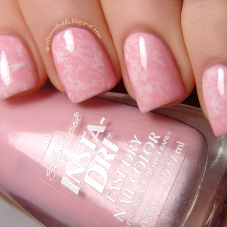 Wear these sweet pink and white saran wrapped nails on Valentine's Day. DIY with the video tutorial here.