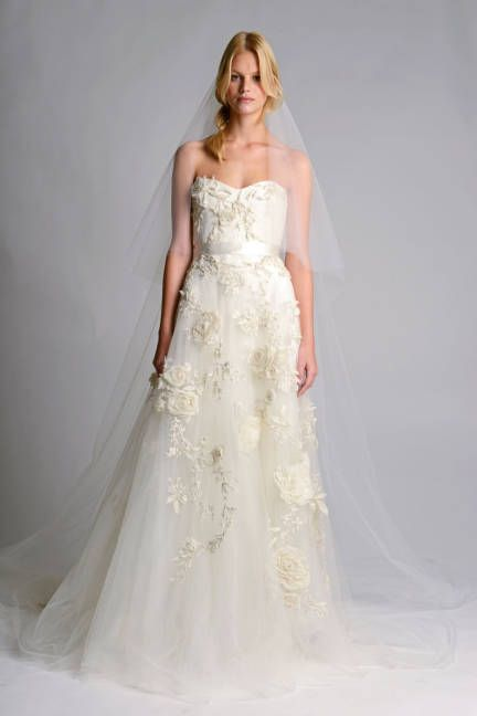 Marchesa's flower-bedecked tulle wedding dress is the perfect match for your bouquet!
