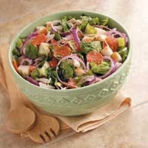 Submarine Sandwich Salad Recipe -If your family's like mine, they won't be able to resist this salad loaded with meat, produce...even bread! The recipe can be easily doubled, so I often prepare it for potlucks.