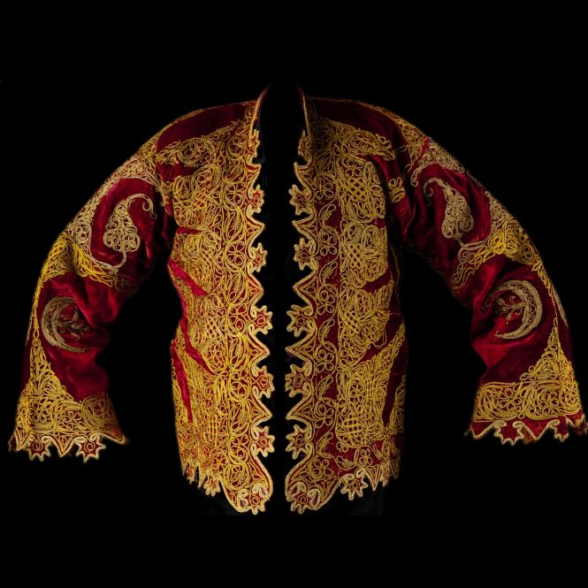 Ottoman Empire jacket, 19th Century. Red velvet richly embroidered with gilded palm branches.