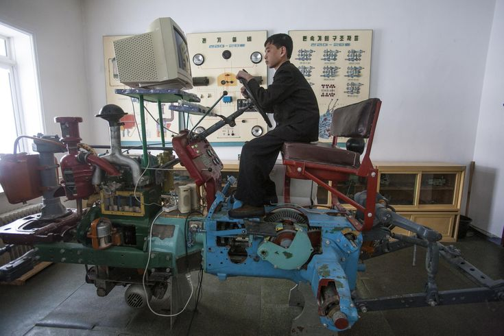 April 3, 2012 A student learns to drive a tractor on a computerized driving simulator at the Samjiyon Schoolchildren's Palace. North Korea David Guttenfelder - 2016 Photo Contest | World Press Photo