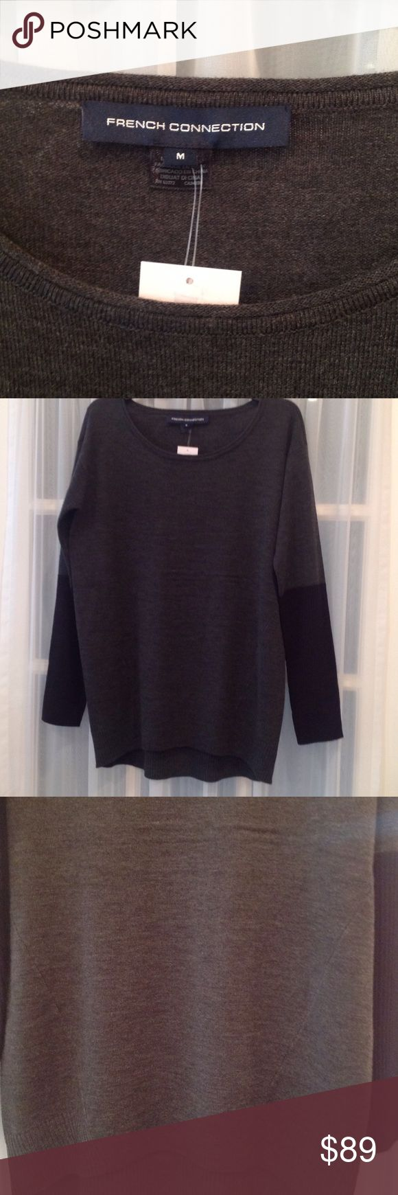 NWT FRENCH CONNECTION COLOR BLOCK SWEATER This is a beautiful hi low gray sweater with black sleeves. Has darts down the front for a slimmer looking fit. It will look great with black leggings. It is machine washable. Made of 100% soft spun acrylic. Very nice. Sweaters Crew & Scoop Necks