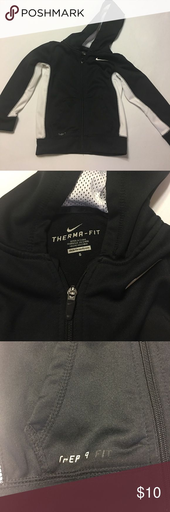 Nike zip up hoodie Black and white nike zip up hoodie. Therma fit. Boys size 5. In great condition except some of the writing on the bottom of jacket has peeled. See third picture Jackets & Coats