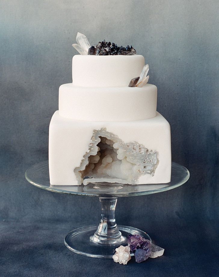 This white marble rock is encrusted into the fondant cake.  All edible.