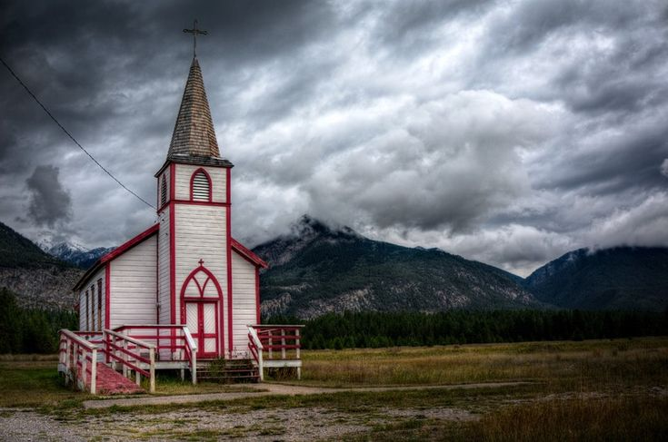 Dark and Stormy Church near the Mountains.