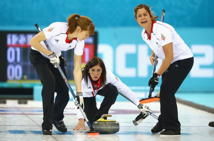 Team GB's bronze curling medallists in action at the Sochi winter Olympic Games, 2014