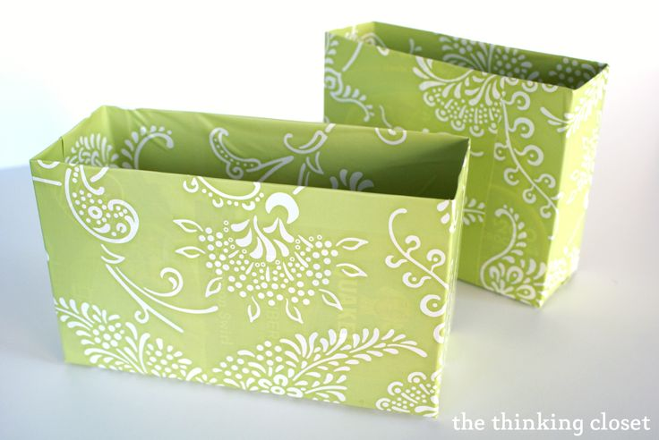 take regular shipping boxes, cover in contact paper, and you have lovely divers for your drawers!