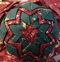"""Tutorial on how to make these quilted star Christmas ornaments-use 2.5"""" squares of material."""