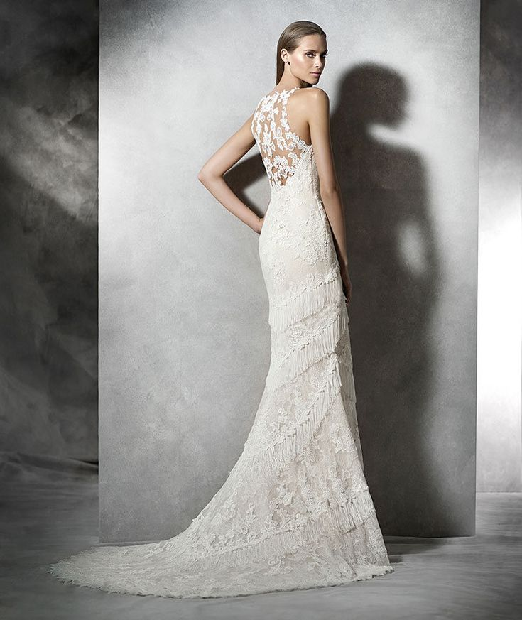 STYLE PLADIA 2016 PRONOVIAS Mermaid wedding dress, beige tulle with lace appliqués, thread embroidery and fringes. Bodice with halter neck and sheer underbodice with rebrodé lace appliqués. Skirt with fringe appliqués. Sheer back with rebrodé lace appliqués.