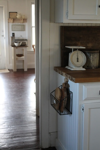 Hanging wire basket to hold cutting boards - love it. from Farmhouse 5540