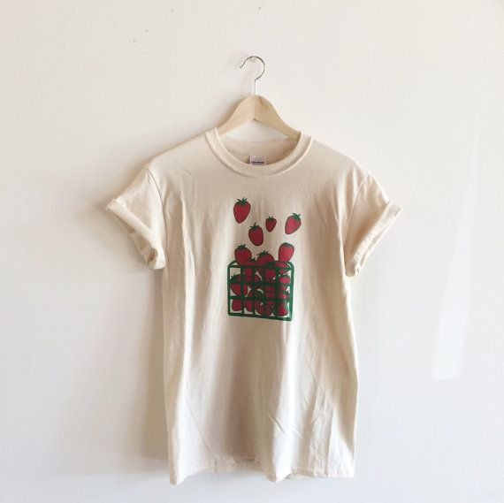 Hand Printed and Hand Drawn!  This is a 100% cotton screen printed t shirt with a hand drawn basket filled with strawberries. Its perfect for summer!