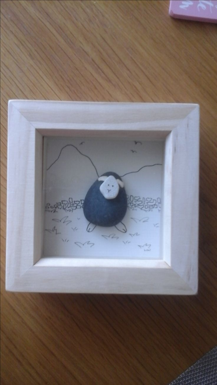 Herdy  sheep made from pebble and sea pottery.