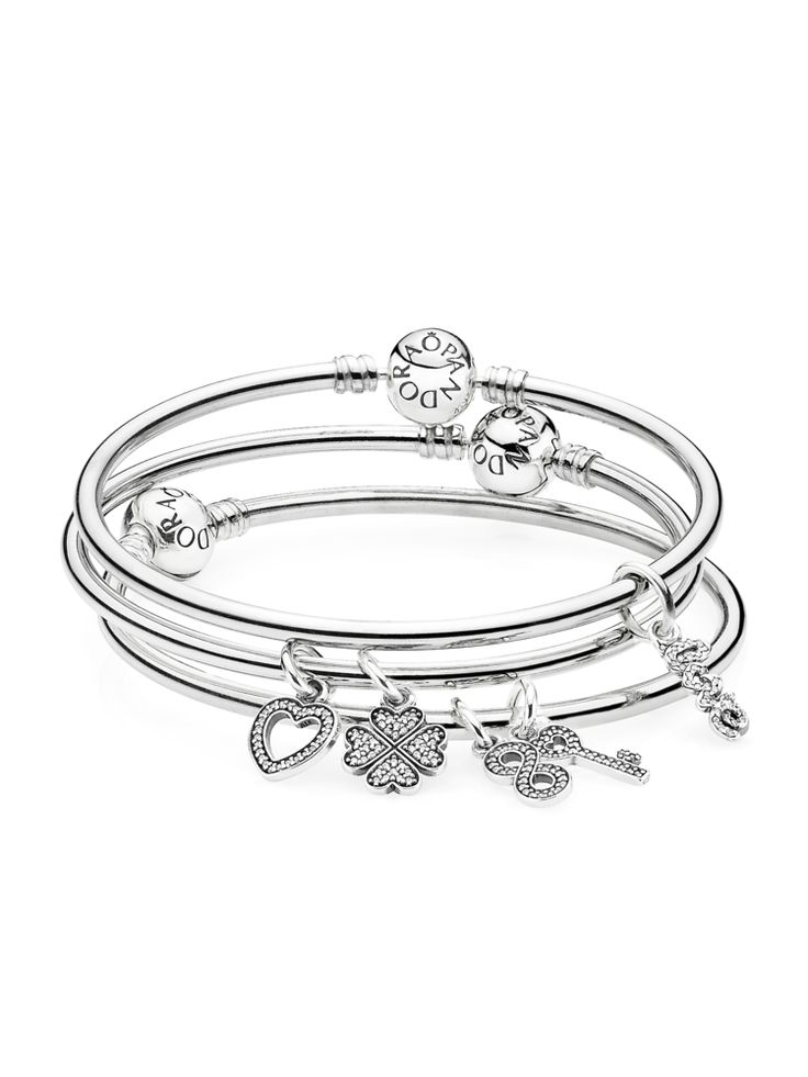 PANDORA's classic sterling silver bangle bracelets are perfect for stacking. Fill up your arms with these beauties for a cool bohemian look. Add charms to make it personal and express your unique style. #PANDORAstyle #PANDORAbracelet