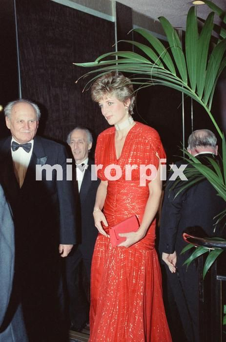 November 18 1991 Princess Diana, attends the Odeon Leicester Square premiere of the film Hot Shots, starring Charlie Sheen. The Princess brought along a couple of uninvited guests, President Arpad Goncz of Hungary, and his wife Szusza. Diana wore a stunning red shot through with gold thread dress, and is pictured here meeting Charlie Sheen.