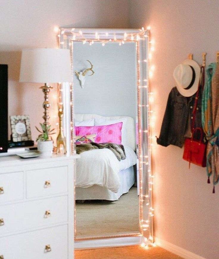 Standing mirror with fairy lights in the corner of the bedroom