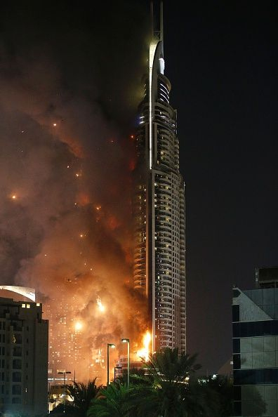 #TOPSHOT A picture taken on December 31 2015 shows the Address Downtown hotel burning after huge fire ripped through the luxury hotel near the world's tallest...
