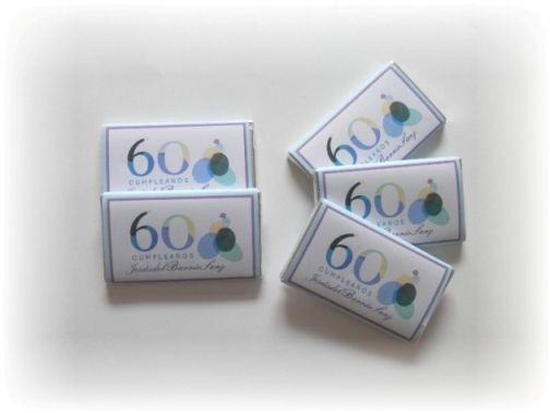 Logotipo personalizado impreso en chocolatinas para personalizar la imagen del 60 aniversario | http://www.limagemarketing.es/eventos/evento-60-aniversario/ | L'image Marketing | Agencia de Publicidad y Comunicación en Sevilla