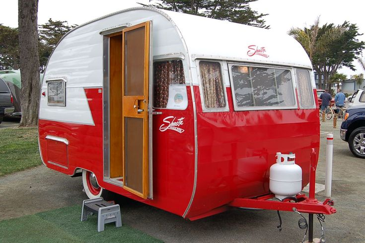 "Slick red and white vintage 1956 Shasta trailer at Pismo Beach...see these and more on my ""Happy Campers"" pin board!"