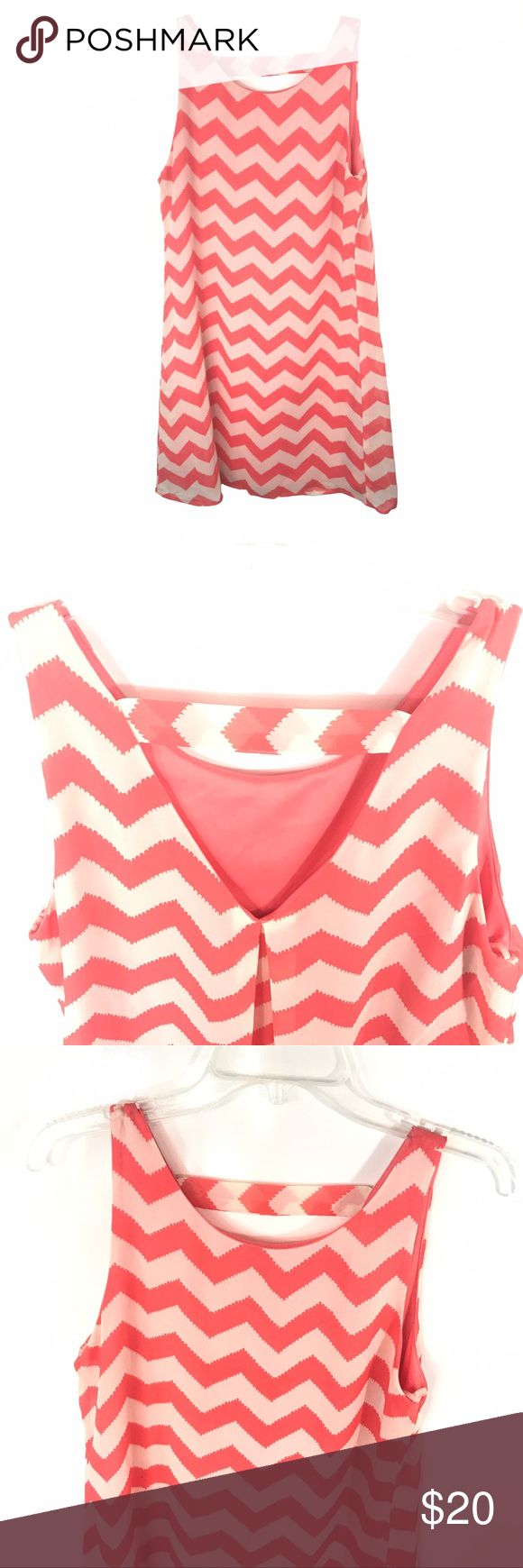 Zig zag flowy dress Coral and off white dress with zig zag design. Cut out in the back. Size small. Flowy. Dresses Midi