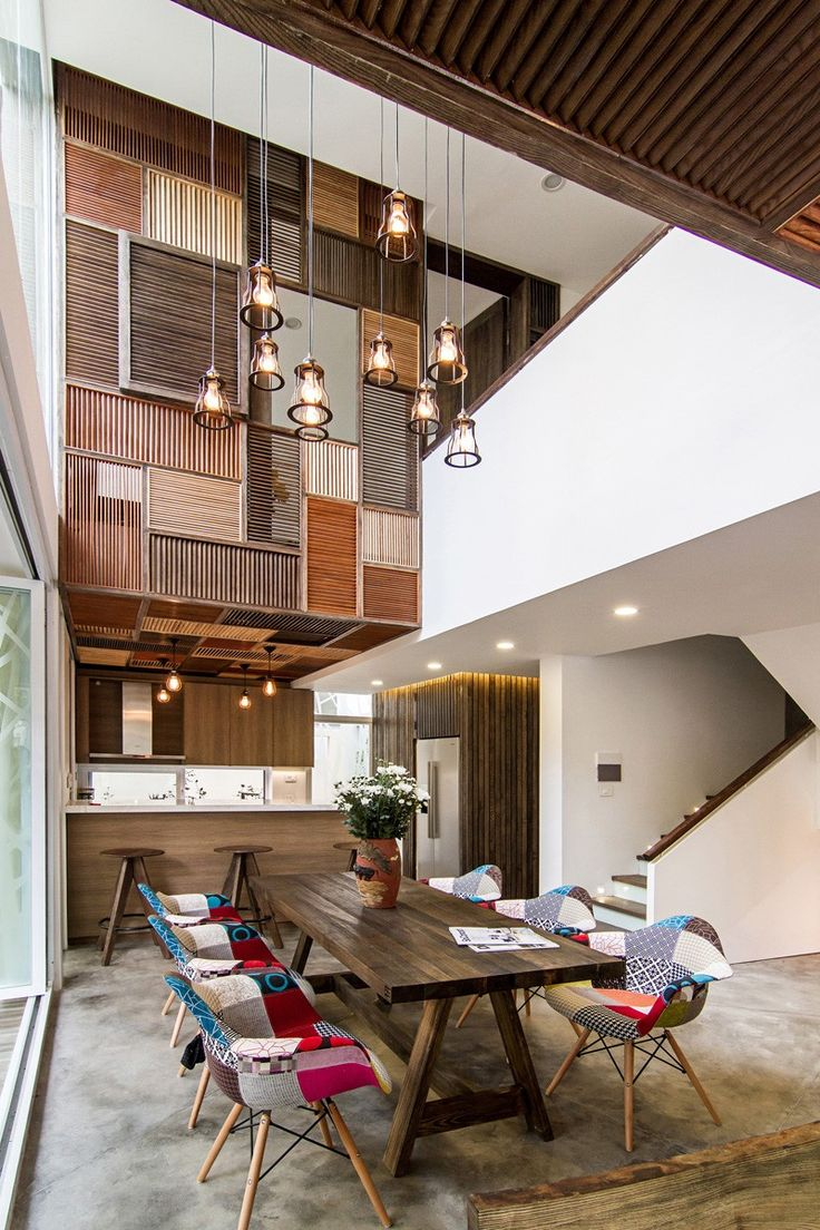 How to make seat cushions for dining chairs moreover white resin - A Gorgeous Patchwork Of Wooden Shutters Transforms This Home In Vietnam