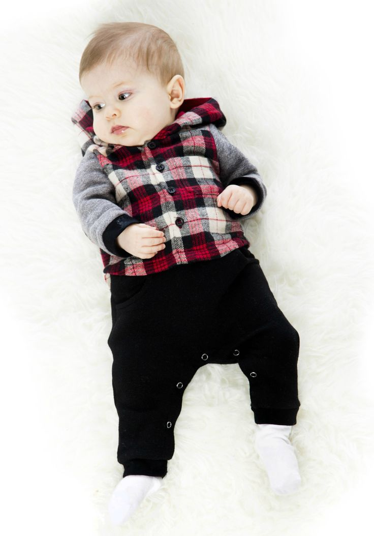 In a one-piece silhouette that looks like two separate pieces, the Plaid Romper boasts bold style in a soft and comfortable fit. This adorable little romper features a poly/cotton plaid flannel top with solid long sleeves, a button front placket, and a plaid hood. The solid French terry bottoms are detailed with round front pockets and snap legs that make diaper changes a cinch.