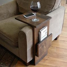 The Handmade Sofa End Table with Side Storage Slot. Make the shelf longer so you can put the laptop on it, and hinge that shelf so it lifts out of the way.