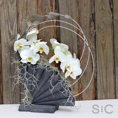 White Orchids in a bespoke steel cone vase