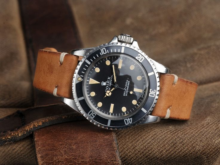Rolex Sub. Ref. 5513 on B&S strap. (Click on photo for high-res. image.) Photo found here: https://bulangandsons.com/portfolio_page/rolex-5513-submariner-papers-hangtag-1970/