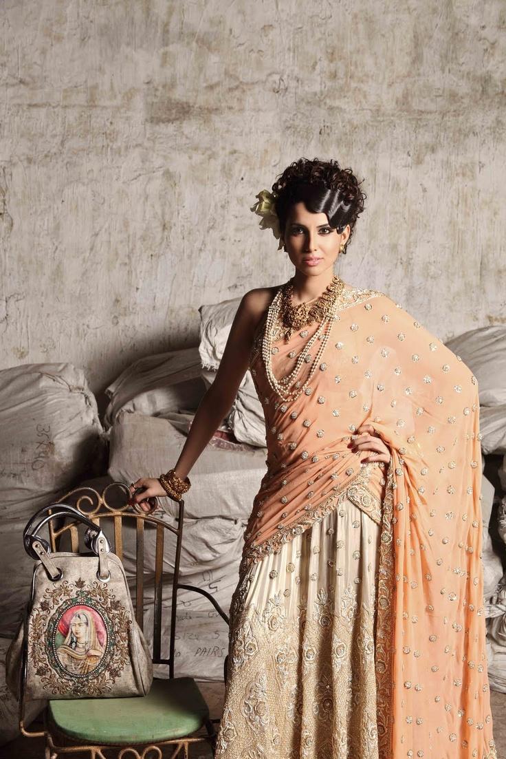 Lehenga worn as a sari, Krshna Mehta| earrings, kadas and necklace, Amrapali| pearl necklace & Maharani bag, Malaga