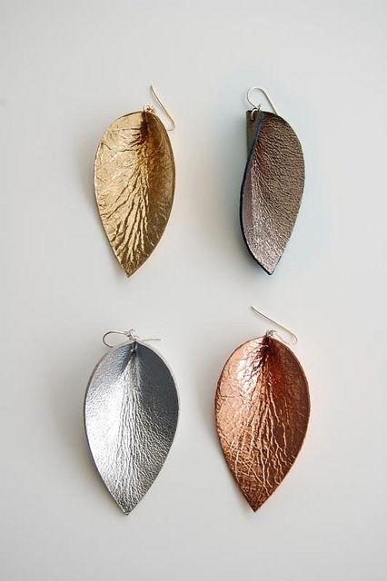 raven leather earrings by ravenandlily, via Flickr...marks on leather added or natural??