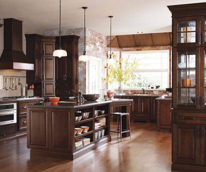 timeless dark cherry kitchen cabinets accented with aged elements like seeded glass and oil rubbed bronze hardware keep a balance between old andu2026