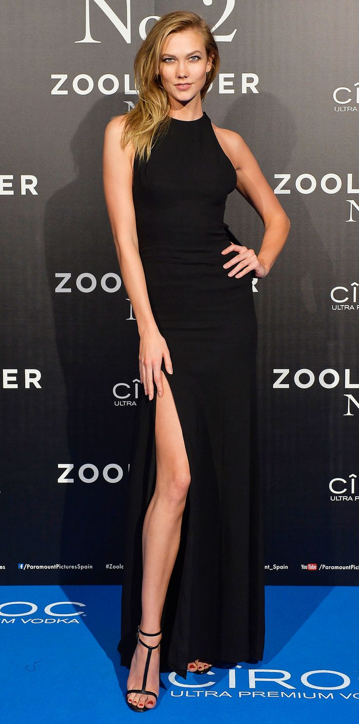 Karlie Kloss was a bombshell at the Zoolander 2 premiere in a cutaway black gown that fit her like a glove. A thigh-high slit revealed her supermodel stems and delicate T-strap sandals.
