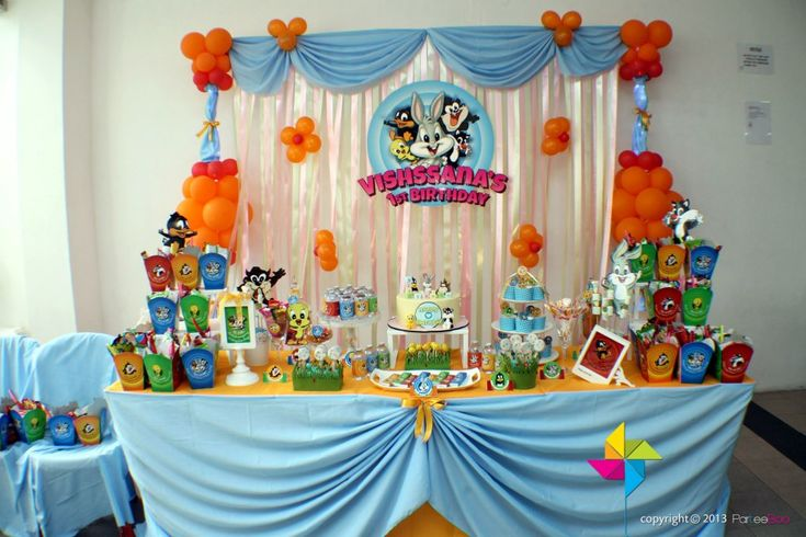 Backdrop & cake / dessert / candy table (Baby Looney Tunes theme). Design & setup by ParteeBoo - The Party Designers