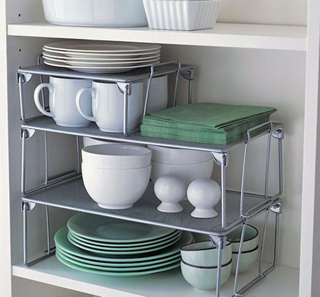 Place shelves inside your kitchen cabinets. >> http://www.godownsize.com/5-tips-for-downsizing-your-kitchen/