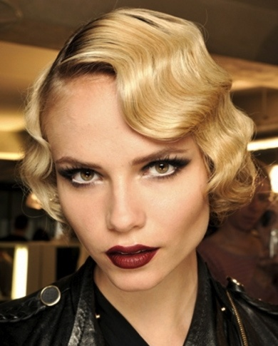 The deep sultry red lips, cat eye makeup and finger-waves are a perfect combination for a vintage look to kill! #vintage #redlips #blonde #vintagelooks #1920s #roaring20s #sexy #sultry www.gmichaelsalon.com