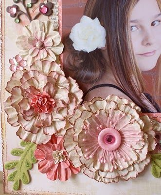 Great tutorial for making these hand made paper flowers!  Bo Bunny blog.