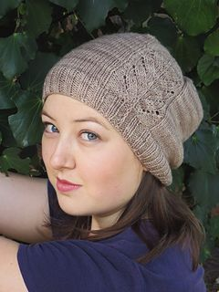 Feather in My Cap is a crown-down, slightly slouched hat, knitted in the round. The feather motif is what makes this minimalistic hat special. The hat is worked primarily in Stockinette stitch, creating the perfect background to highlight the lace feather motif and ensuring that this hat is a fast and relaxing knit. The slip-stitch shaft of the feather is continued down through the brim ribbing, giving the appearance of a feather on a hat.