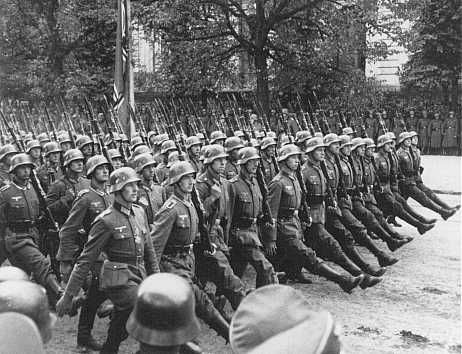 "German Invasion of Poland. An excellent picture of the German style of formal marching called ""goose stepping"". It could only be done for a short distance because of its difficulty."
