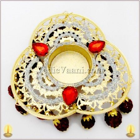 Vedicvaani.com| Handmade Designer Diyas for festivals like Ganapati, Navratri and Diwali Online, Flashy Rudraksh Diya, Flashy Rudraksh Diya set in the center of a multicolored and well decorated hanging 5 mukhi Java Rudraksh. It's a tradition to light a lamp first before starting any auspicious events or rituals. Light symbolizes the absence of darkness,grief & unhappiness. Almighty's divine grace is spread all over the house by lighting the lamps.