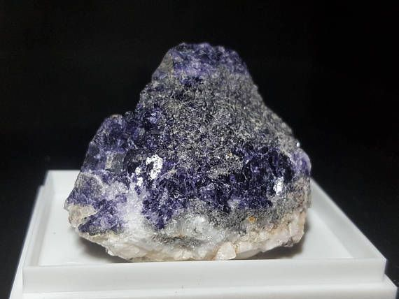 Very beautiful, deep purple fluorite in association with red hematite, on limestone. The specimen comes from The Burren in county Clare in Ireland and was collected in September 2017. You will receive your lovely specimen in a box, as pictured. Size: ca.4.3cm. Weight: 59g.