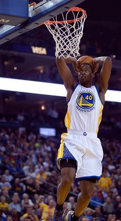 Description of . Golden State Warriors' Harrison Barnes gets set to slam home two points against the Los Angeles Lakers during the first quarter of an NBA basketball game, Monday, March 16, 2015, at Oracle Arena in Oakland, Calif. (D. Ross Cameron/Bay Area News Group)