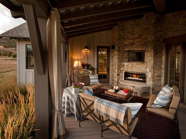 The outdoor living room borrows its palette from the adjoining great room and offers a front-row seat to the changing seasons. A grilling station, flat-screen TV and gas fireplace are among the main attractions of this entertaining and relaxation space, which successfully blurs the line between indoors and out.