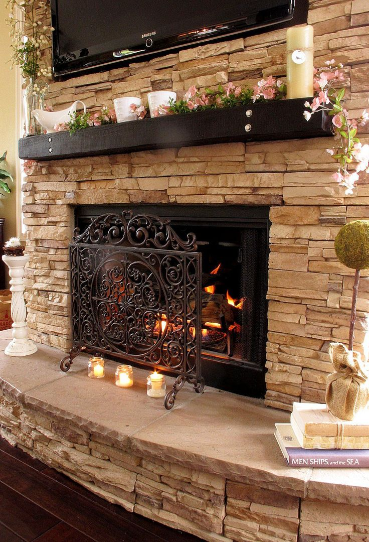 Cool Stone Fireplace Mantels for Interior Design: Tv Over Fireplace And Stone Fireplace Mantels With Floating Mantel Shelf Also Fireplace Scree And Tea Light Candles With Hardwood Flooring And Stacked Stone Fireplace Mantle Plus Wooden Mantels